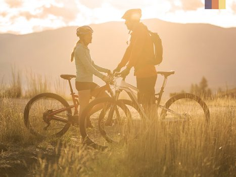 Couple on bikes at the sunset
