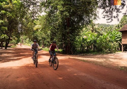 Cyclists ride in Cambodia
