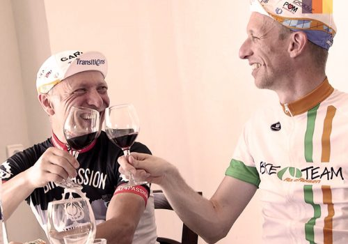 Cyclists drink wine