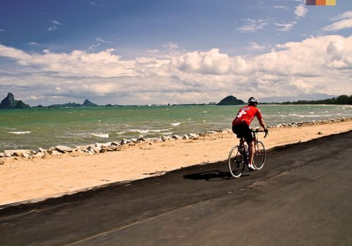Cyclist rides along the coastline