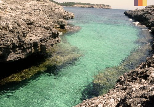 Clear blue water of the Cala Mesquida