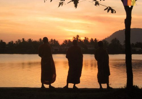 Monks looks at the sunset in Cambodia
