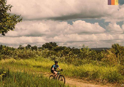 Cyclist rides in Cambodia