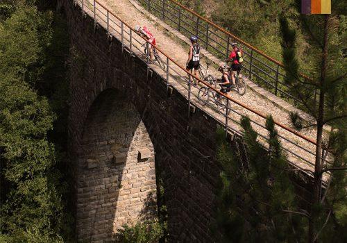 Cyclists standing at a bridge in Croatia