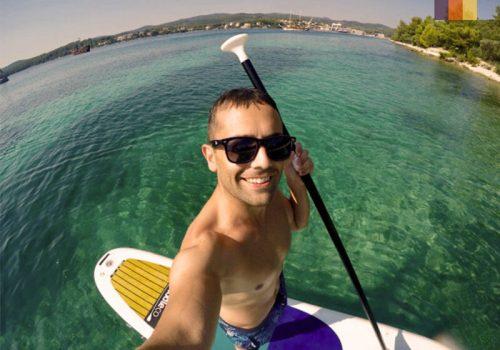 Man taking a selfie on his peddling board