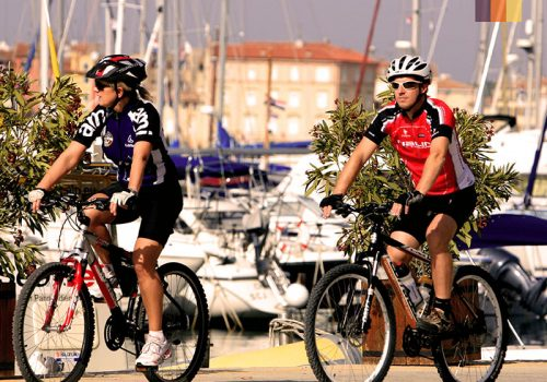 Cyclists ride along the have in Croatia