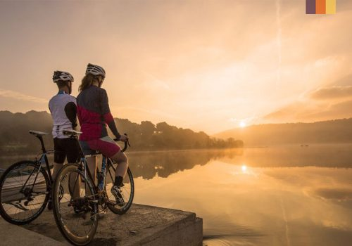 Cyclists enjoying the view of the sunset at Croatia
