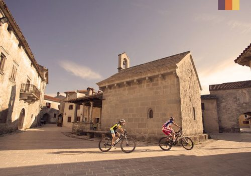 Cyclists riding through the old towns in Croatia