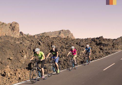 Cyclists on an E-Bike in Tenerife