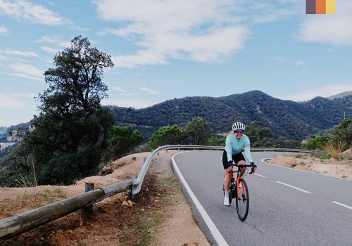 Cyclist rides on the Girona roads