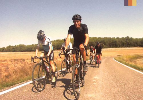 Cyclists riding through the flat roads of Girona
