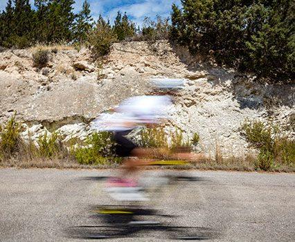 Cyclist rides fast in Ibiza