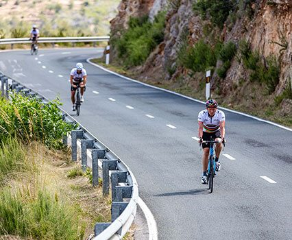 Cyclists ride on the roads of Ibiza