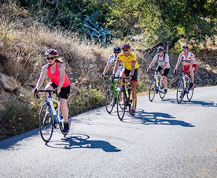 Cyclists ride in Ibiza
