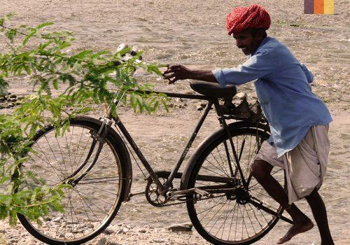 Indian holds bike