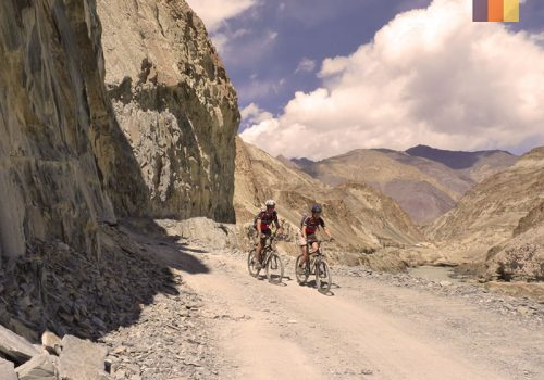 Cyclists ride along the Warila pass in India