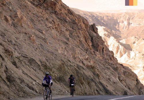 Cyclist rides along a cliff