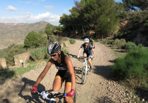 Cyclists ride in the mountains in La Manga