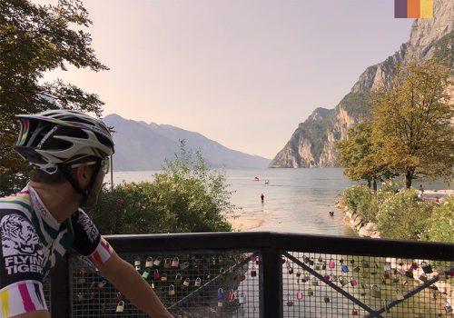Cyclist looks at Garda lake