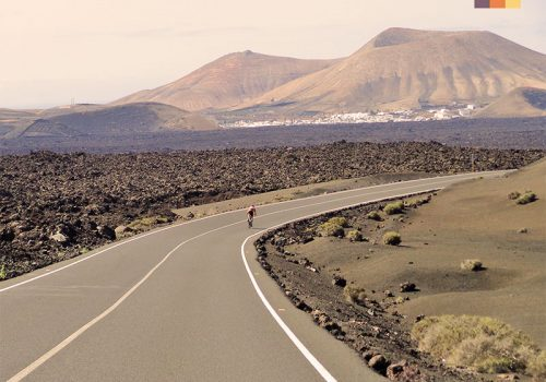 Cyclist rides in the mountainous landscape of Lanzarote