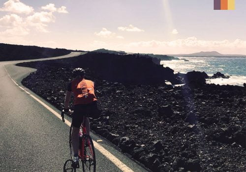 Cyclist rides along the coast in Lanzarote