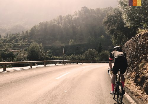 Cyclist rides of the hill in Mallorca