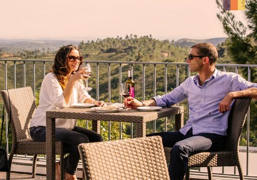 Couple drinks local wine in Portugal