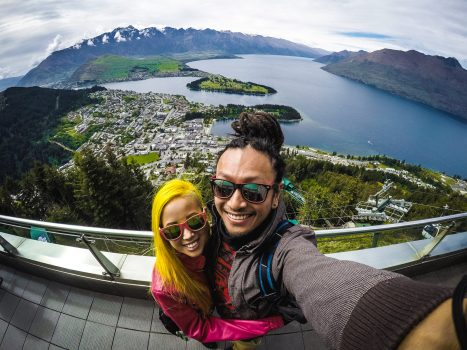 Couple take a selfie with the beautiful landscape of New Zealand