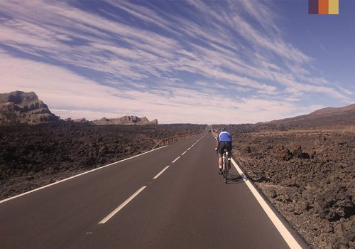 Cyclist rides on the road in Tenerife