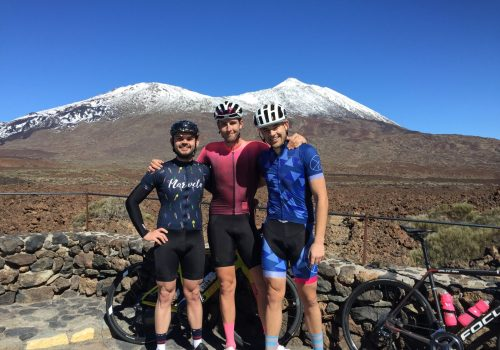 Cyclists pose for the Mount Teide