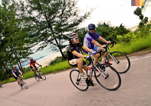 Cyclists ride along the coast of Vietnam