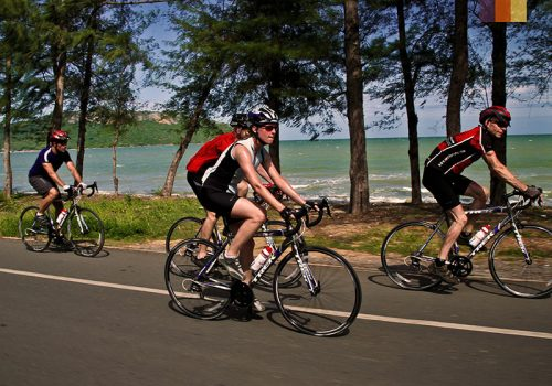 Cyclists ride along the coast in Vietnam