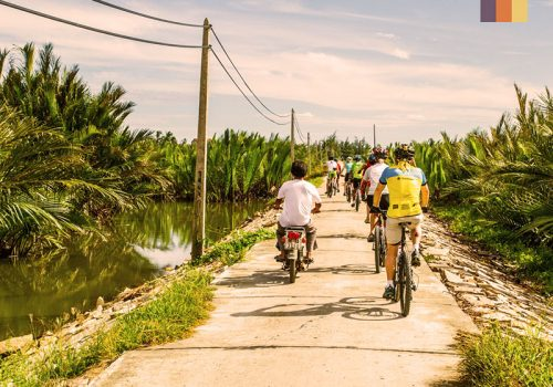 Cyclists ride through the Vietnamese village