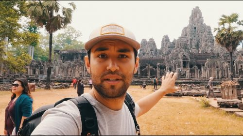Man takes a selfie with the Angkor Wat