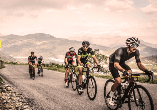 cyclists on mountains roads in france, competing in the etape du tour cycling sportive