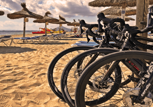 bikes standing on the beach behind sunbeds in Mallorca