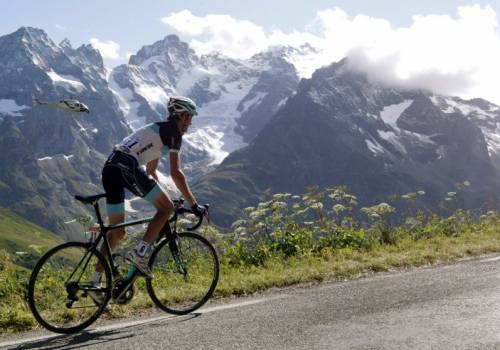 Cyclist cycles up the Col du Galibier