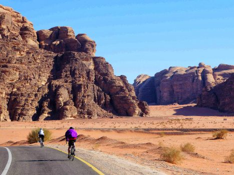 Cyclists ride on the red sanded roads in Israel