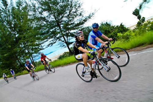 Group of cyclists ride in Thailand