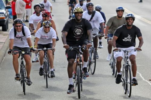 LeBron James and his fans on a bike