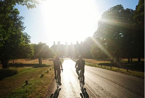 Cyclists ride in the Richmond Park