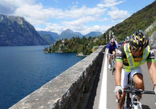Cyclists ride along the Garda Lake