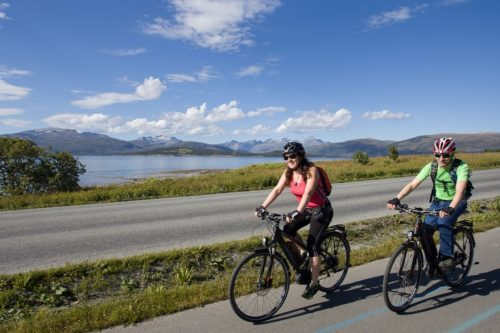 Cyclists on an E-bike