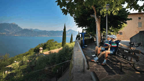 2 Cyclists taking a break at the Lake Garda
