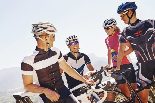 Group of cyclists talking to each other
