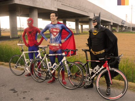 Superheroes on a bike