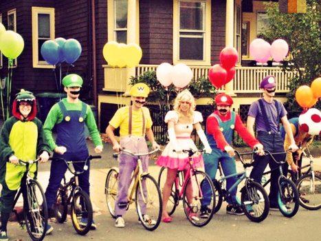 Team sky costumes on a bike