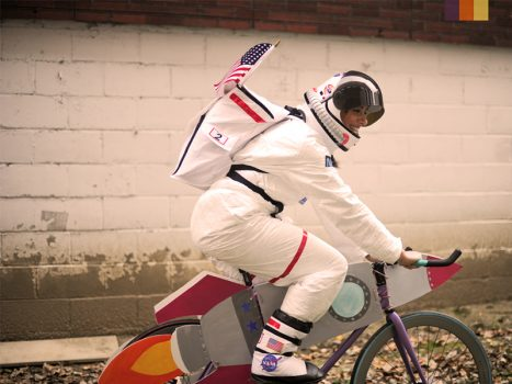 Cyclist in a Nasa costume