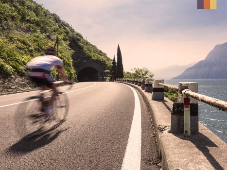 Cyclist ride along the coastline of Lake Garda