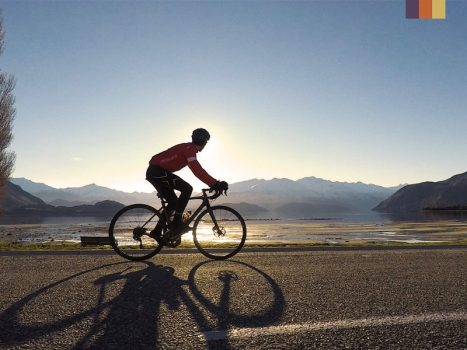 Cyclist rides through New Zealand tops